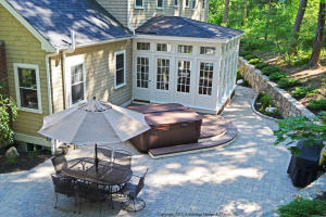 Patio with hot tub and seating area
