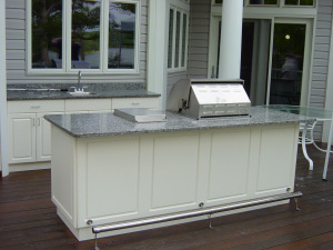 granite top outdoor kitchen with grill