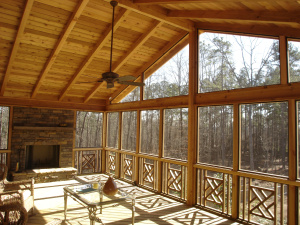 screened porch with fans and fireplace