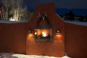 built in fireplace lit at night