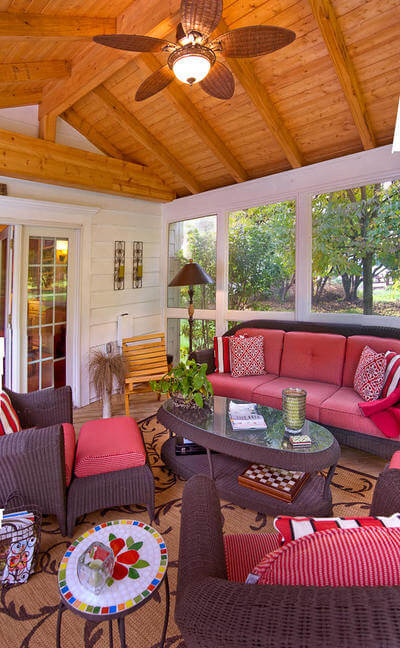 Cozy screened porch with ceiling fan and lighting