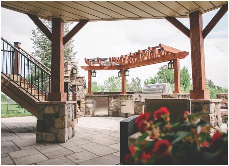 Custom patio with outdoor kitchen and pergola