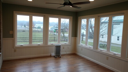 Interior view of sunroom with ceiling fan