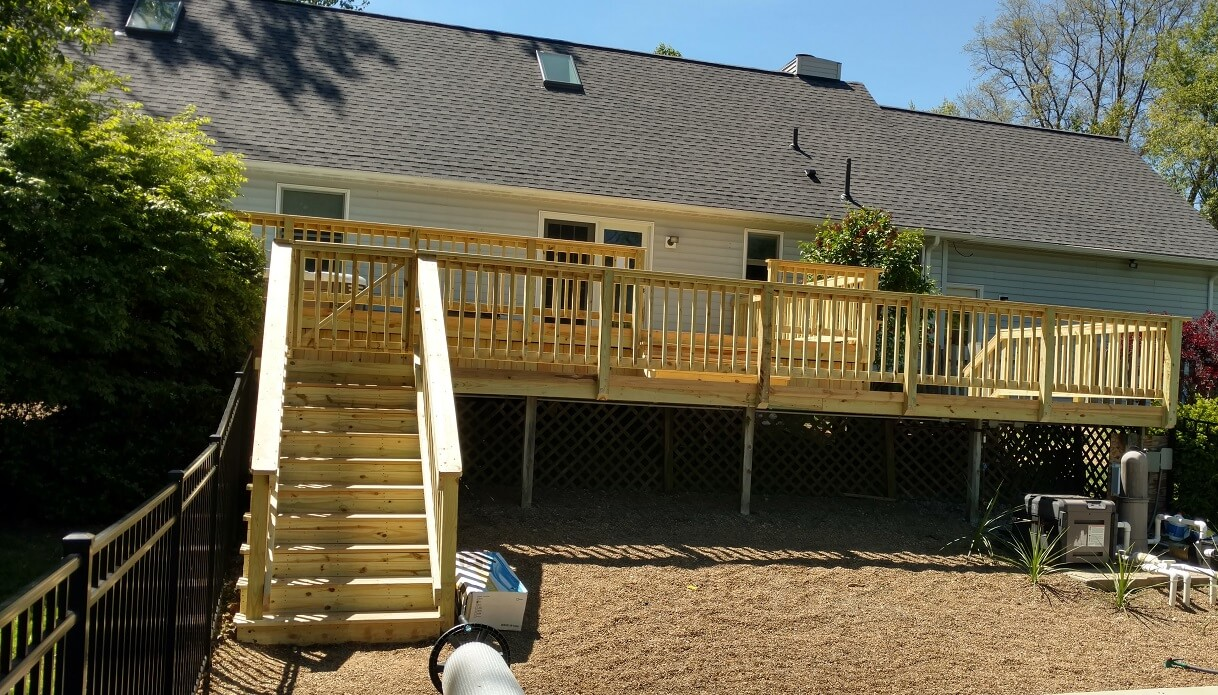Wood deck with railing and staircase