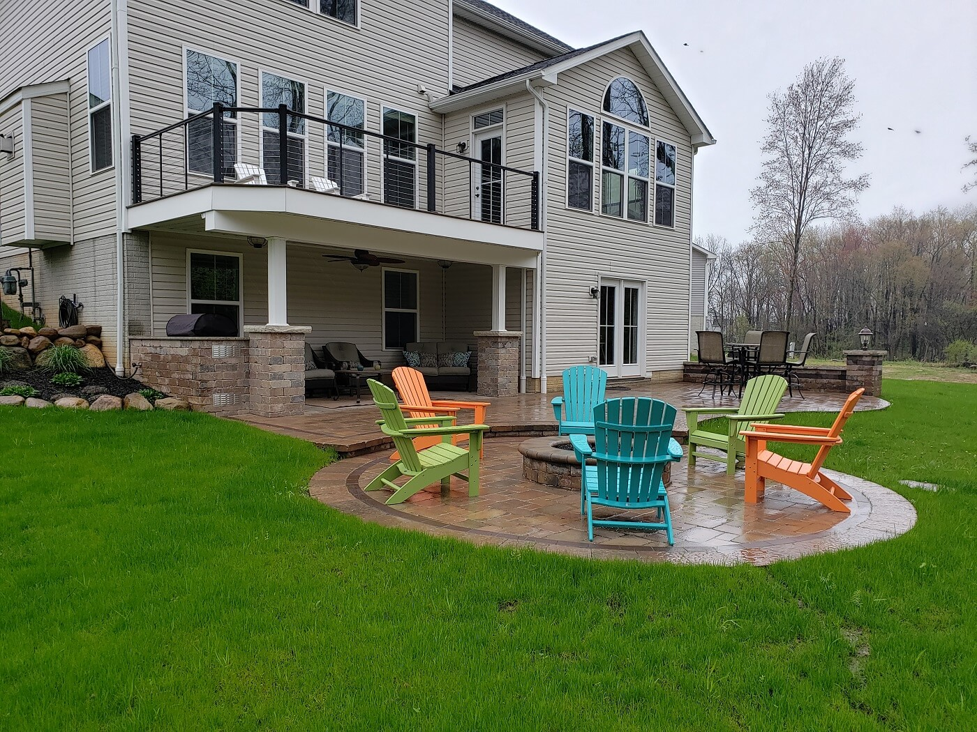 Patio with fire pit and colorful chairs