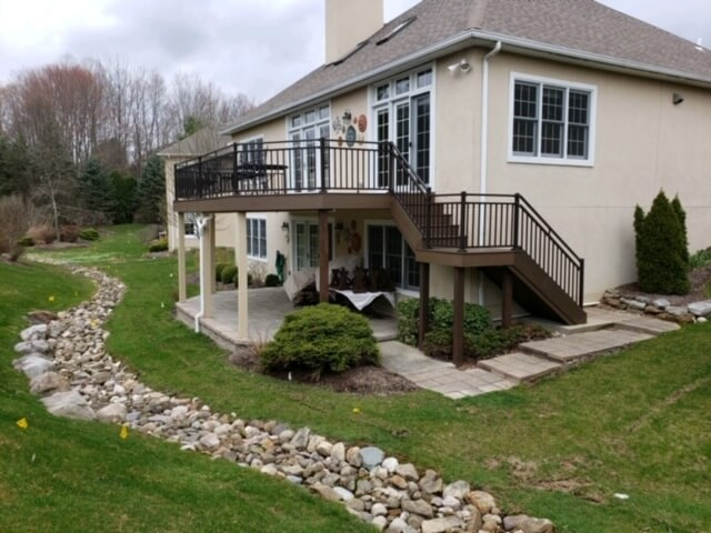 Backyard wood deck with railing and staircase