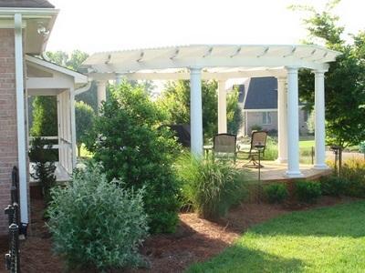 Pergola with round columns over patio