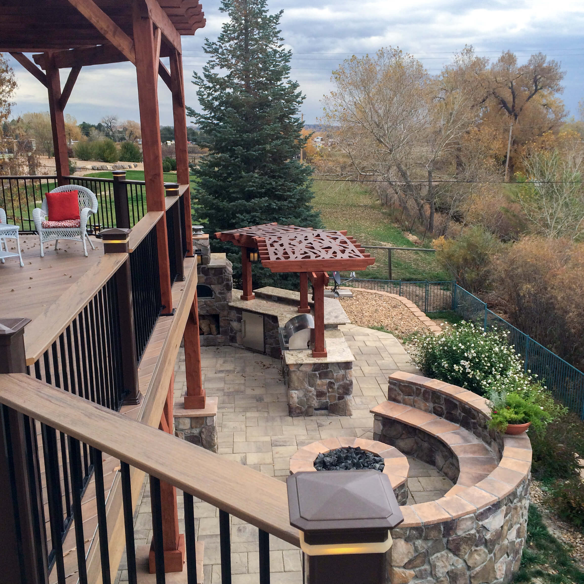 Deck and patio with outdoor kitchen and fire pit