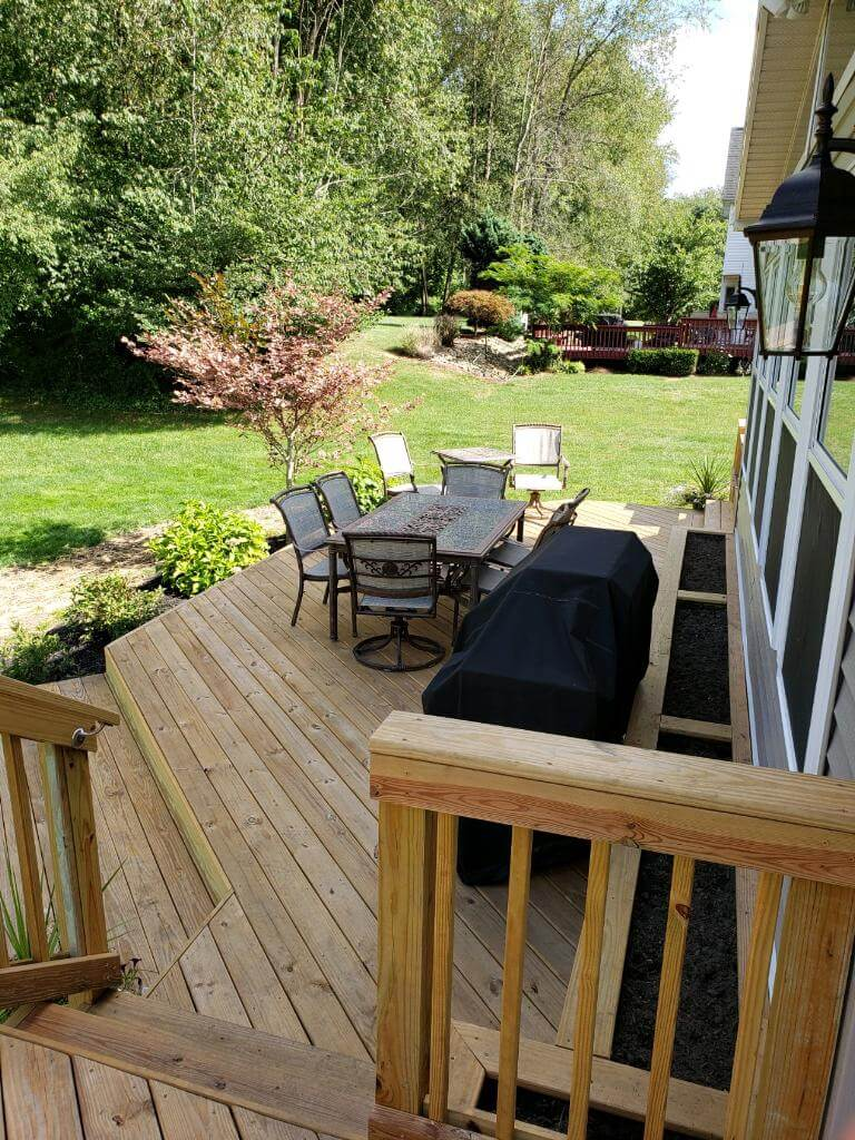 Backyard wood deck with dining area