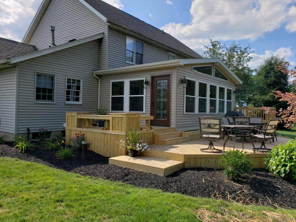 Wood deck with planters and seating area