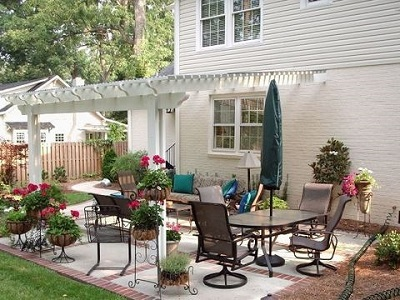 Patio with pergola over seating area