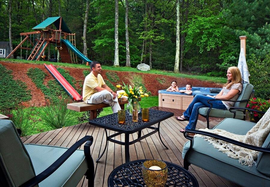 Family enjoying backyard deck