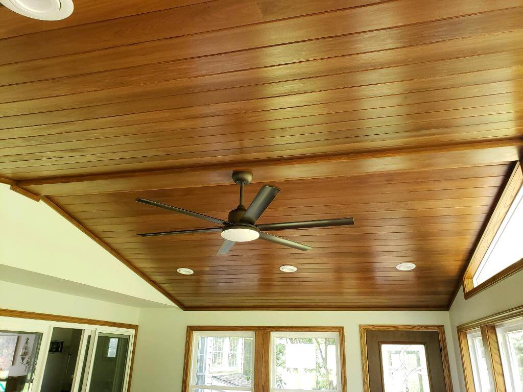 Three season room ceiling with fan and lighting