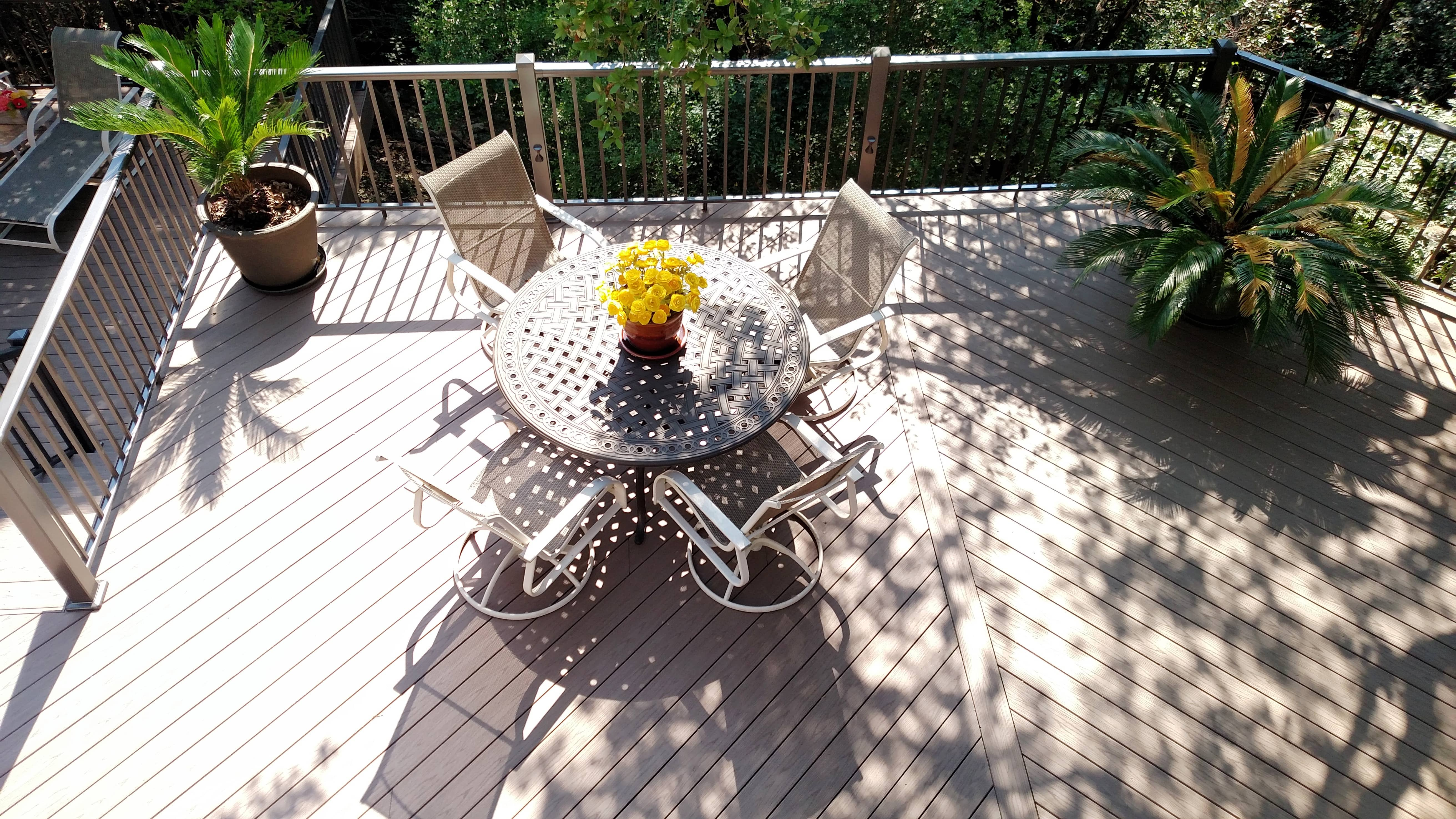 Wood deck with seating area and railing