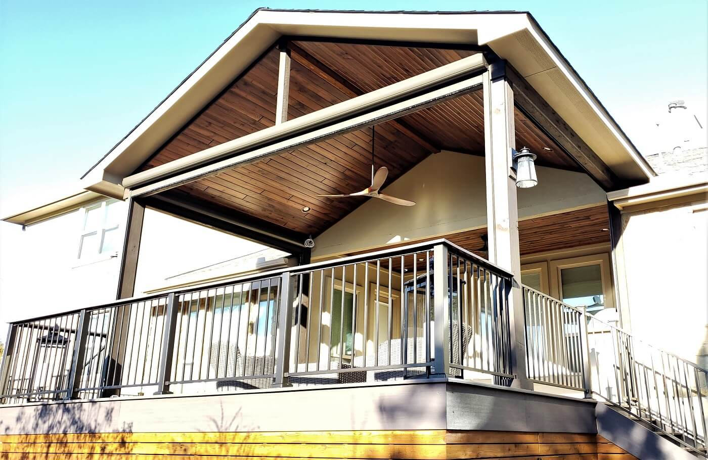 Covered porch and deck with railing