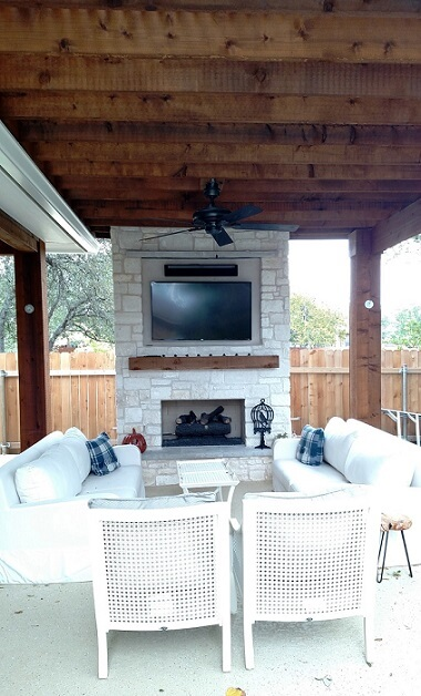 Custom outdoor fireplace on covered porch