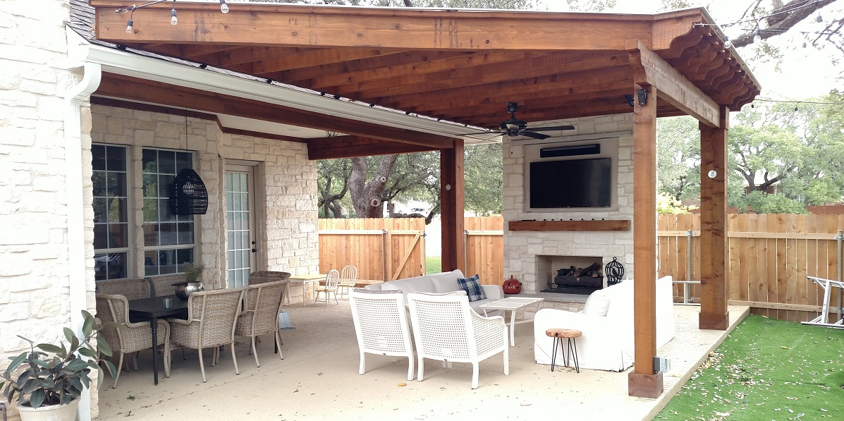 Outdoor space with outdoor fireplace and seating area