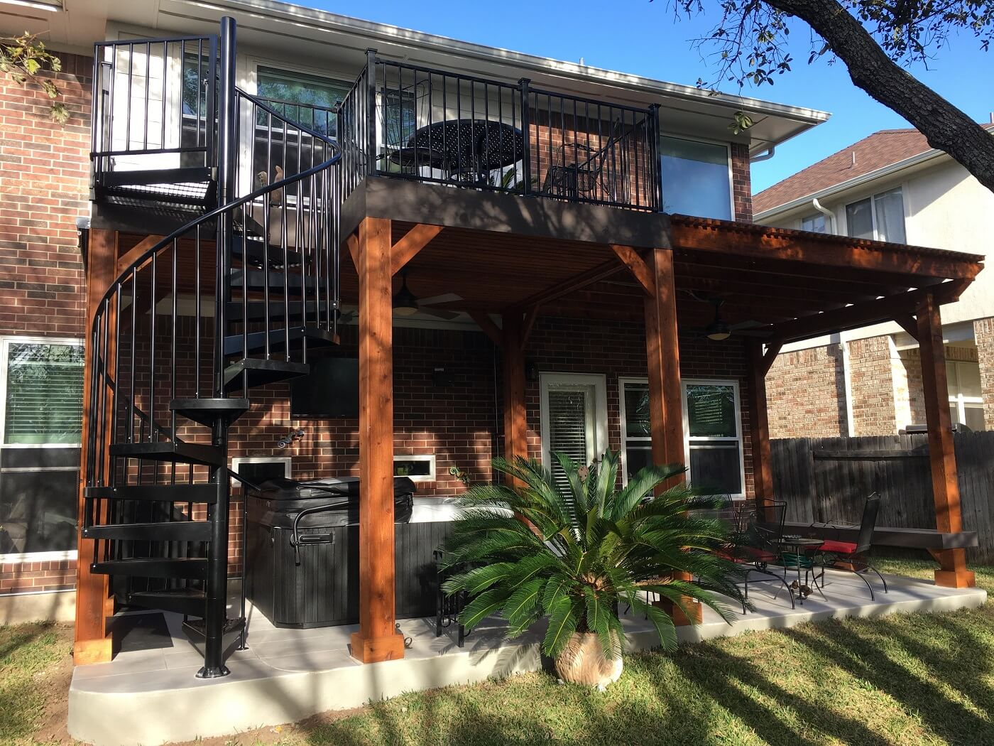 Custom wood deck with spiral staircase