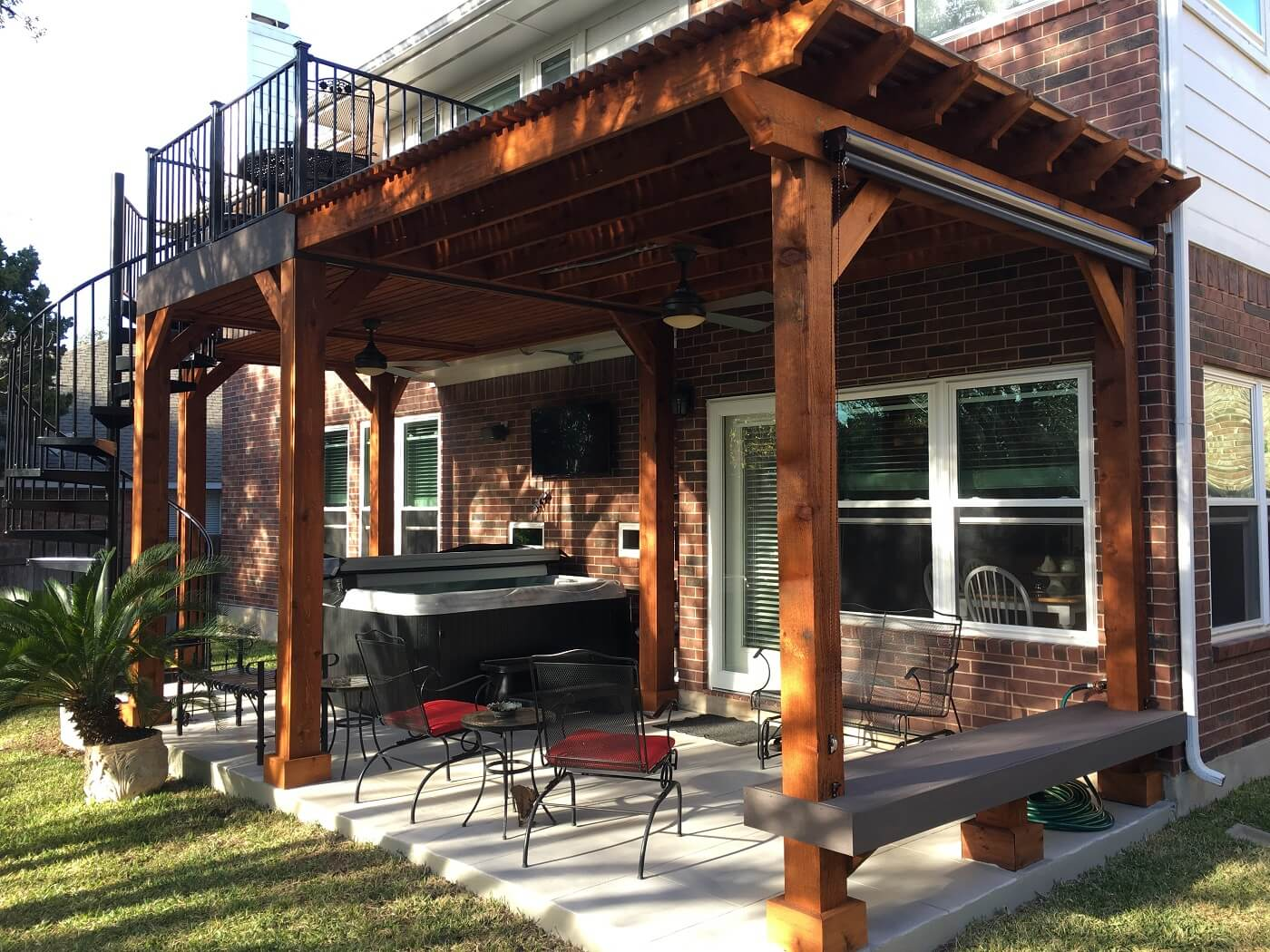 Elevated deck and patio with spiral stairs and hot tub
