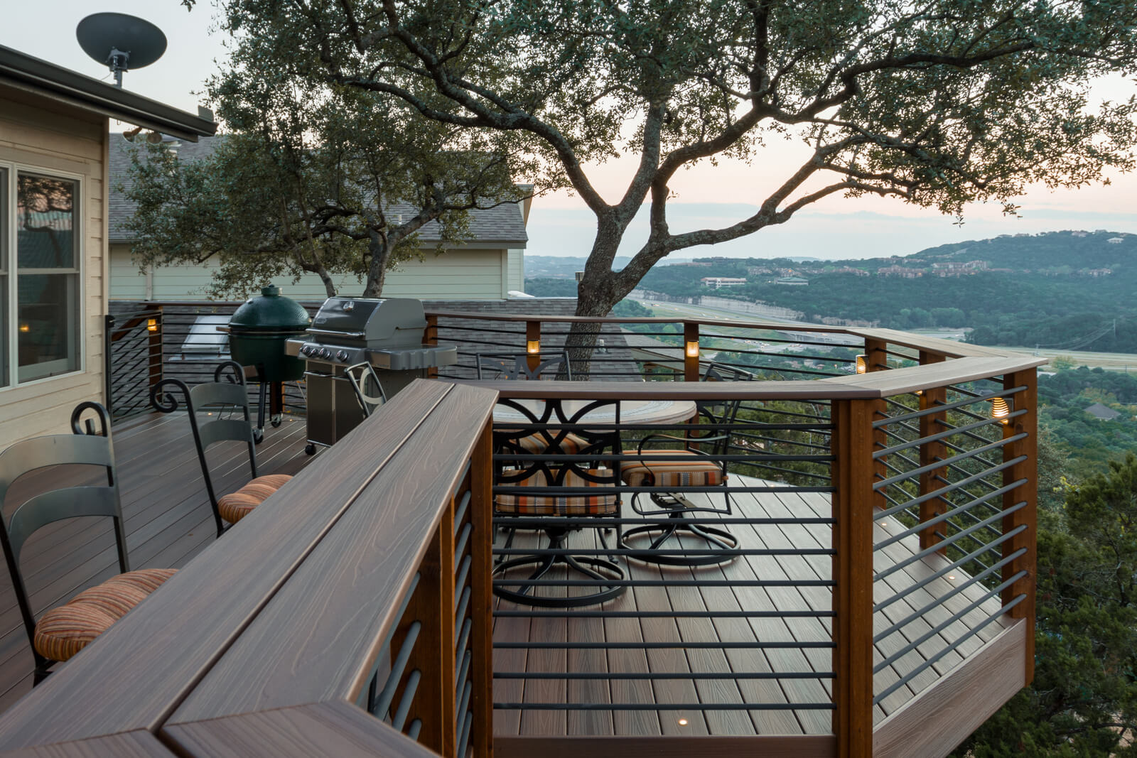 Backyard wood deck with outdoor kitchen