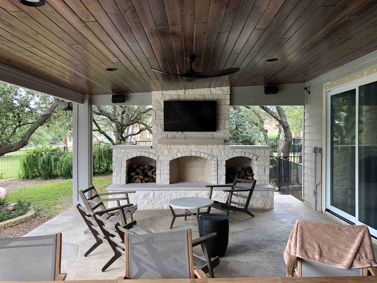 Outdoor fireplace attached to covered patio