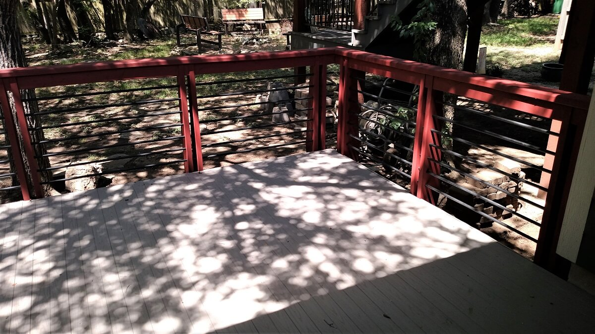 Backyard wood deck with railing
