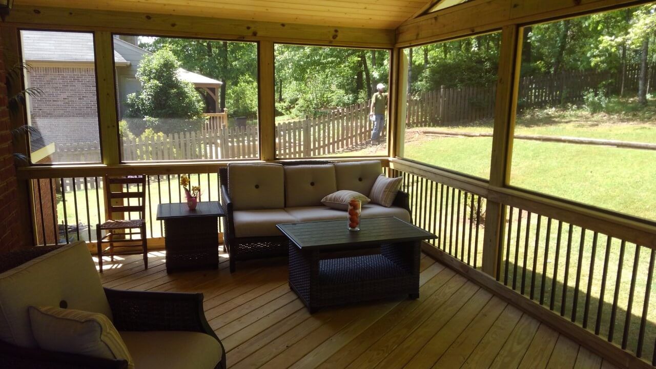 Cozy seating area on screened porch