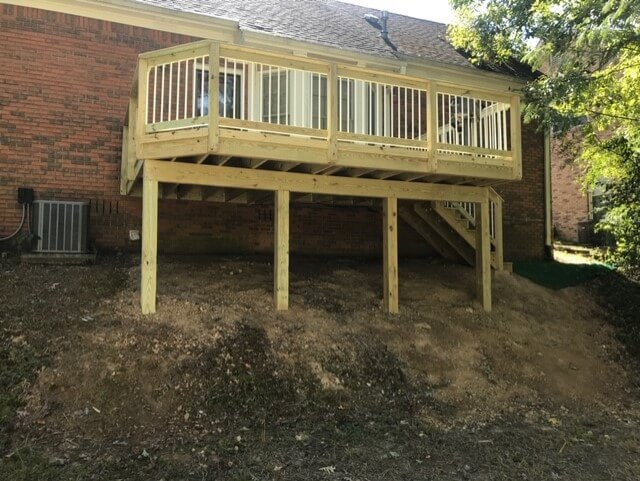 Elevated wood deck with balusters
