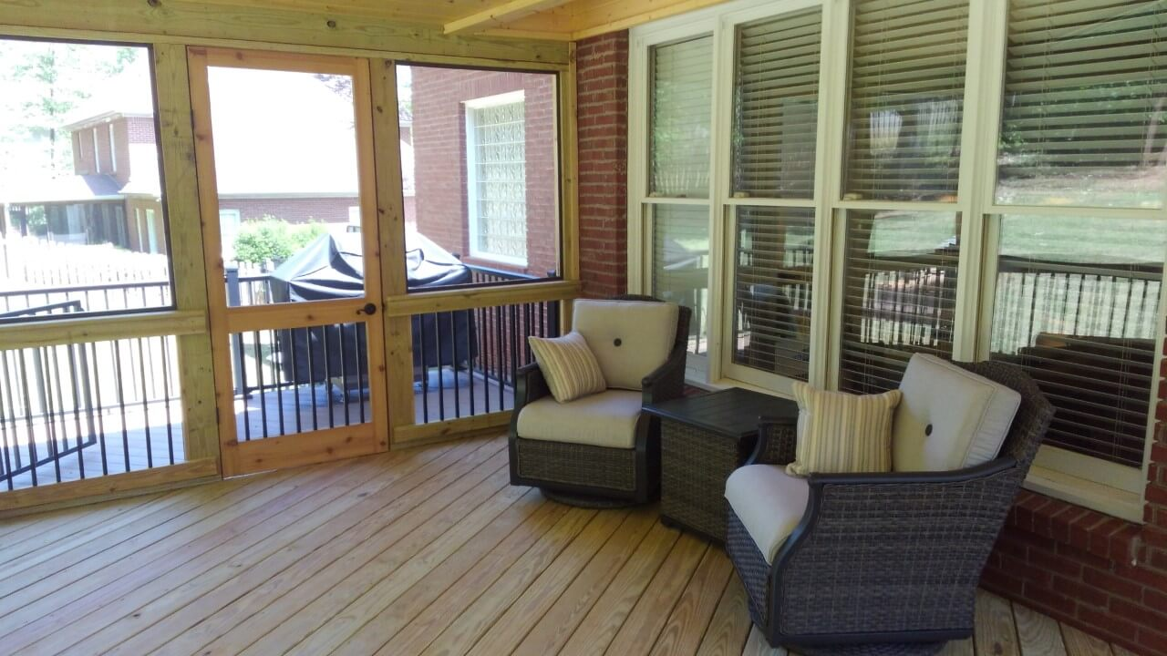 Seating area on screened porch and deck outside