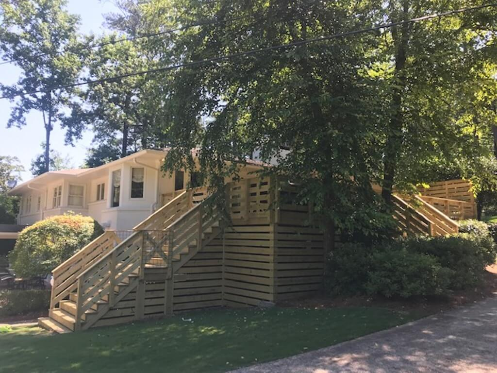 Double staircases on wood deck