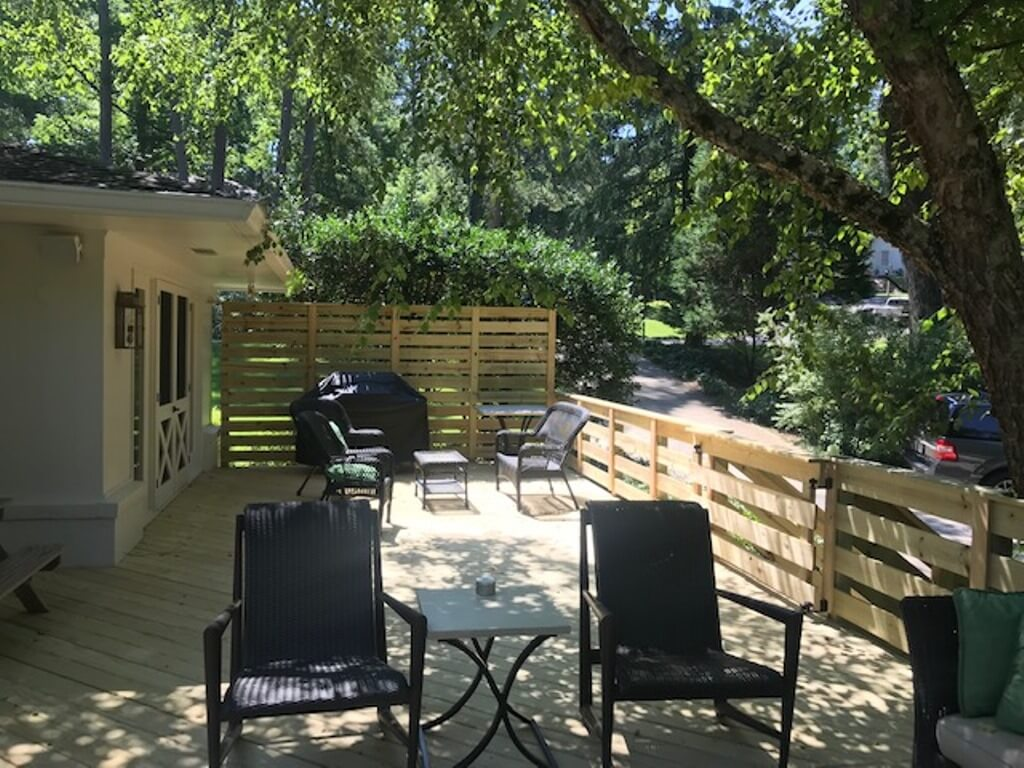 Seating area and outdoor kitchen on custom wood deck