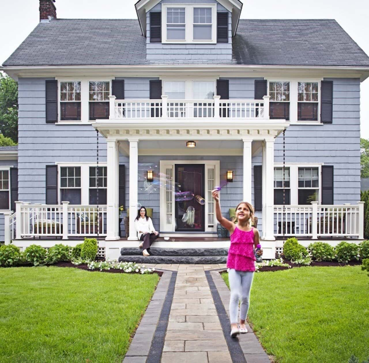 girl in front of porch