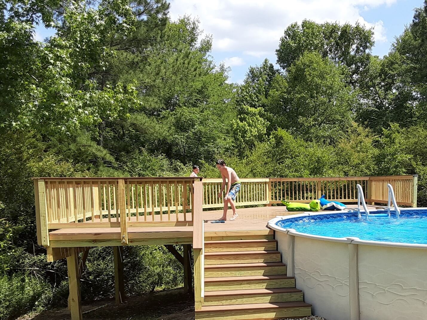 Kids playing on poolside deck