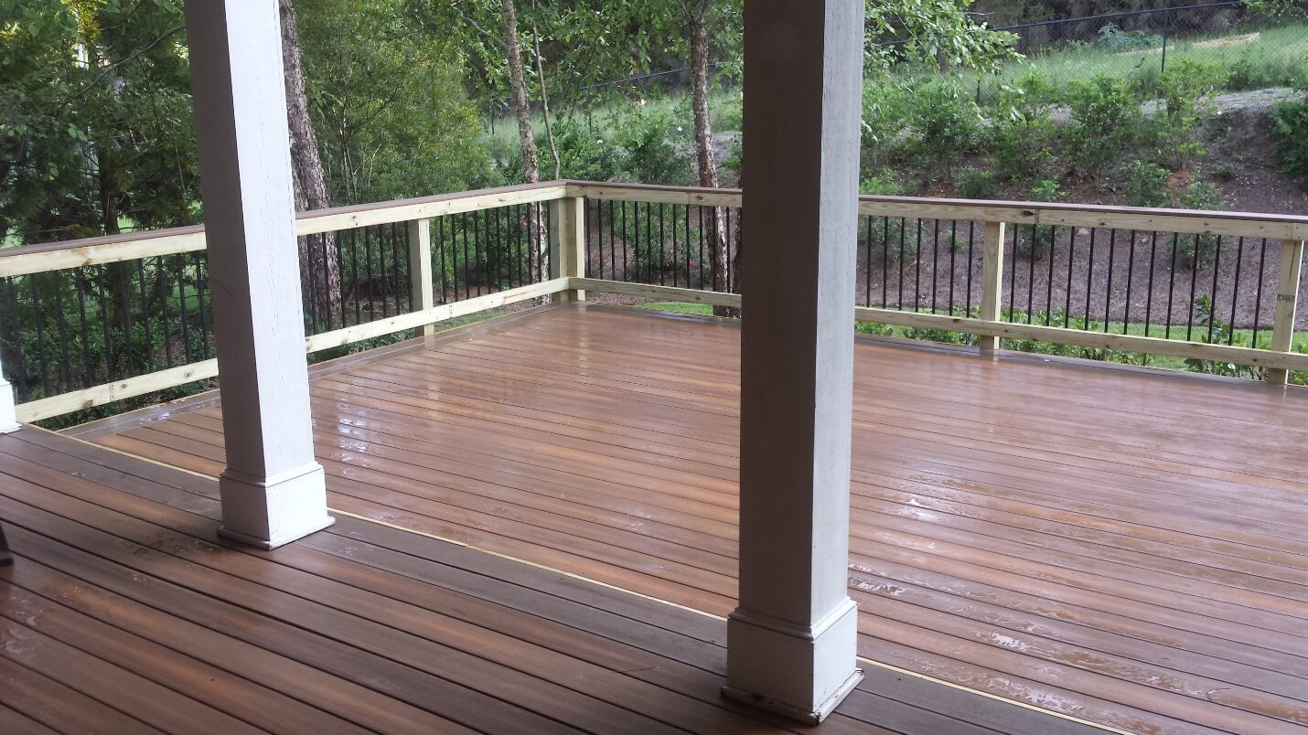 Wood deck with white pillars