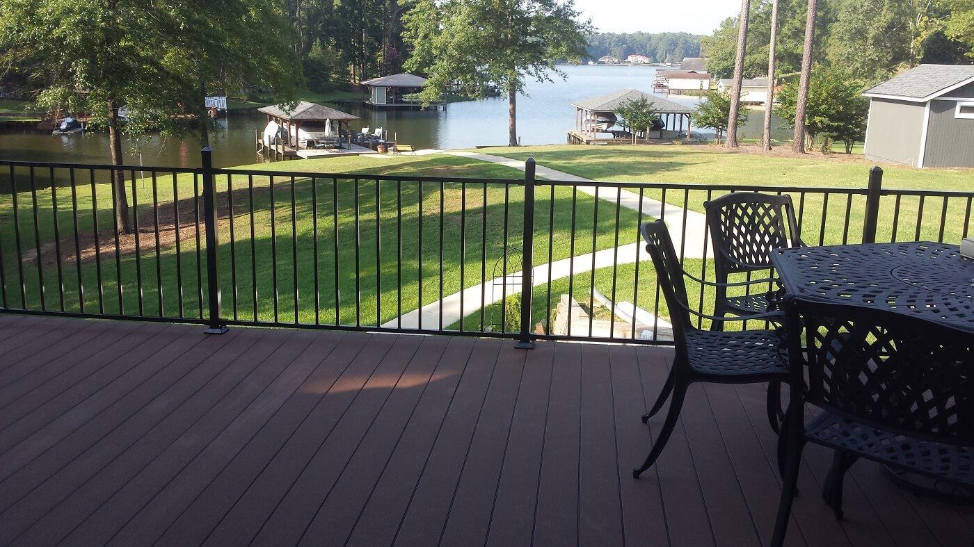 Custom deck with railings overlooking lake