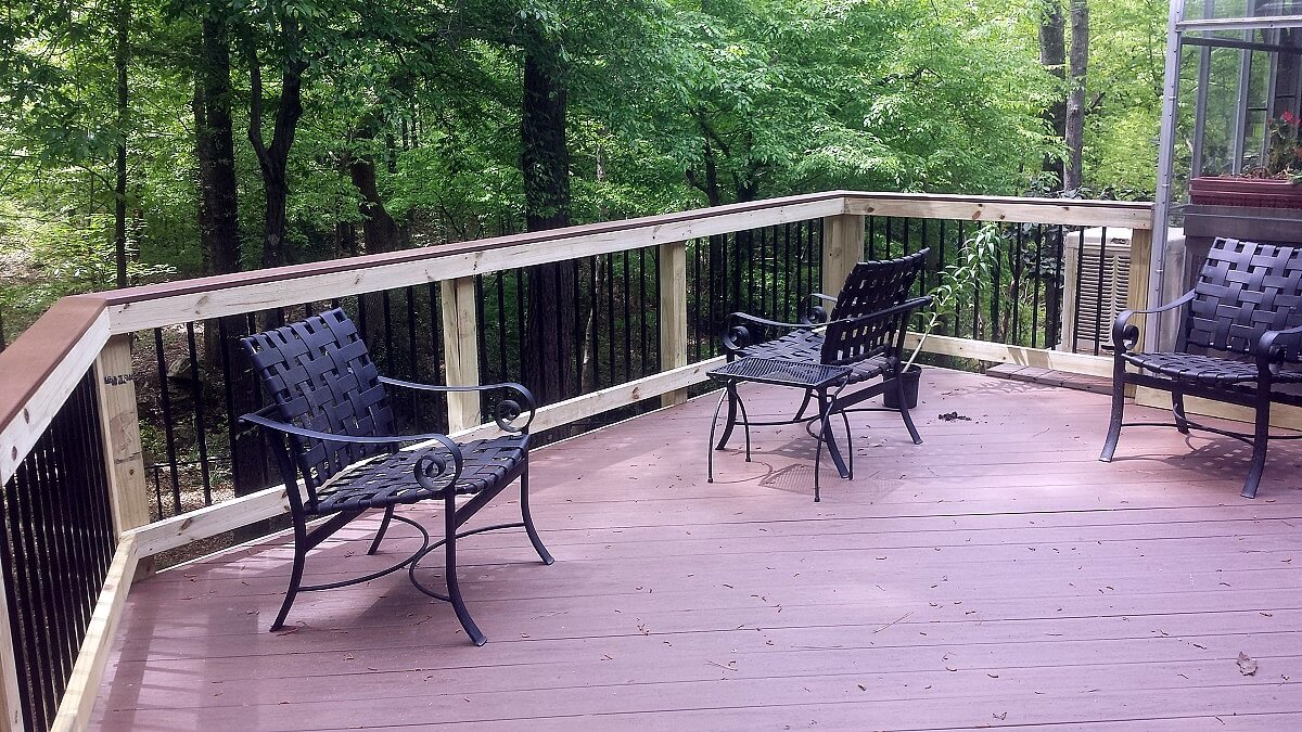 Backyard deck with black chairs