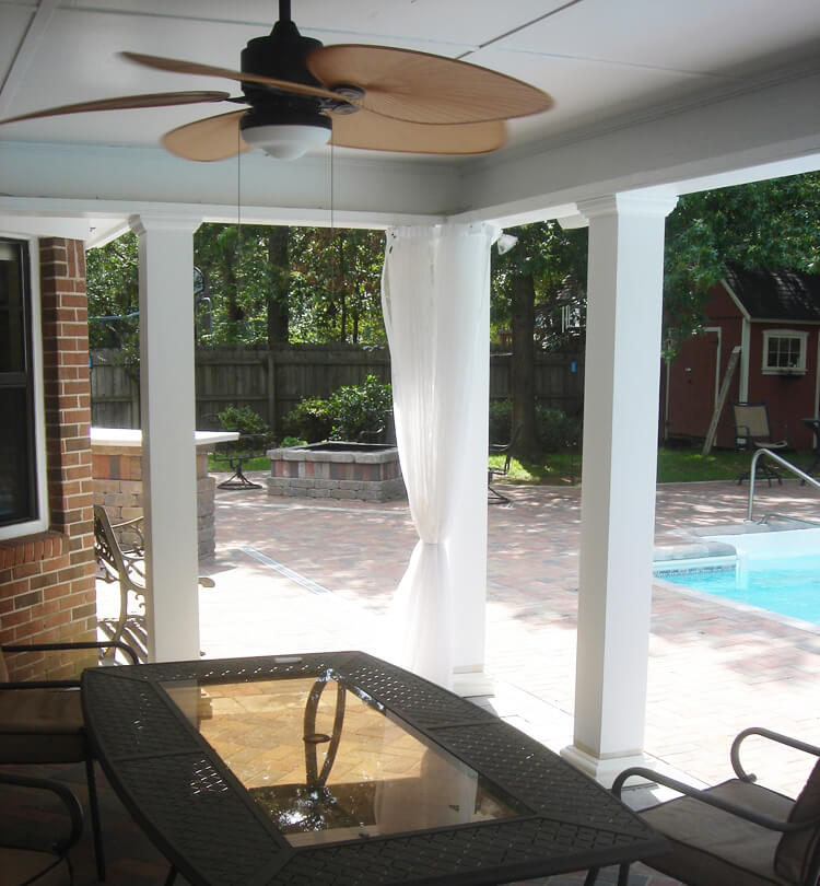 Poolside porch with flat roof