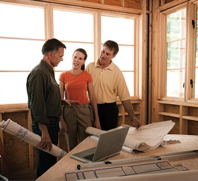 Couple and company worker discussing plans
