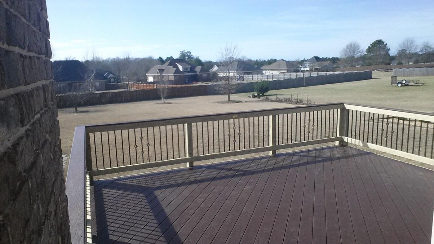 Custom low maintenance deck with backyard view