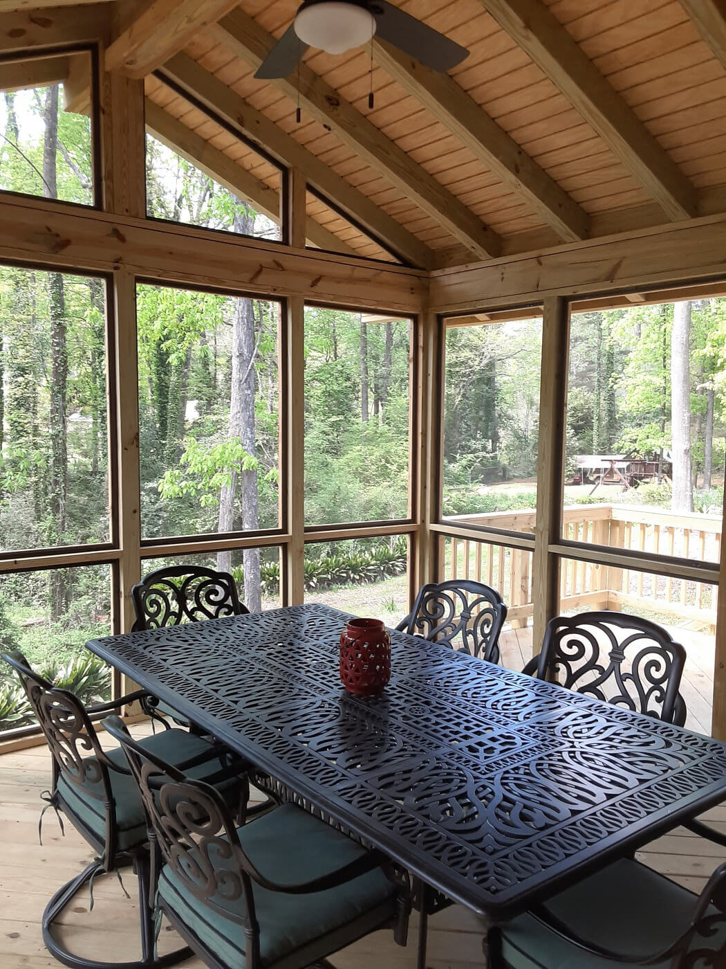 Interior view of screened porch with dining area