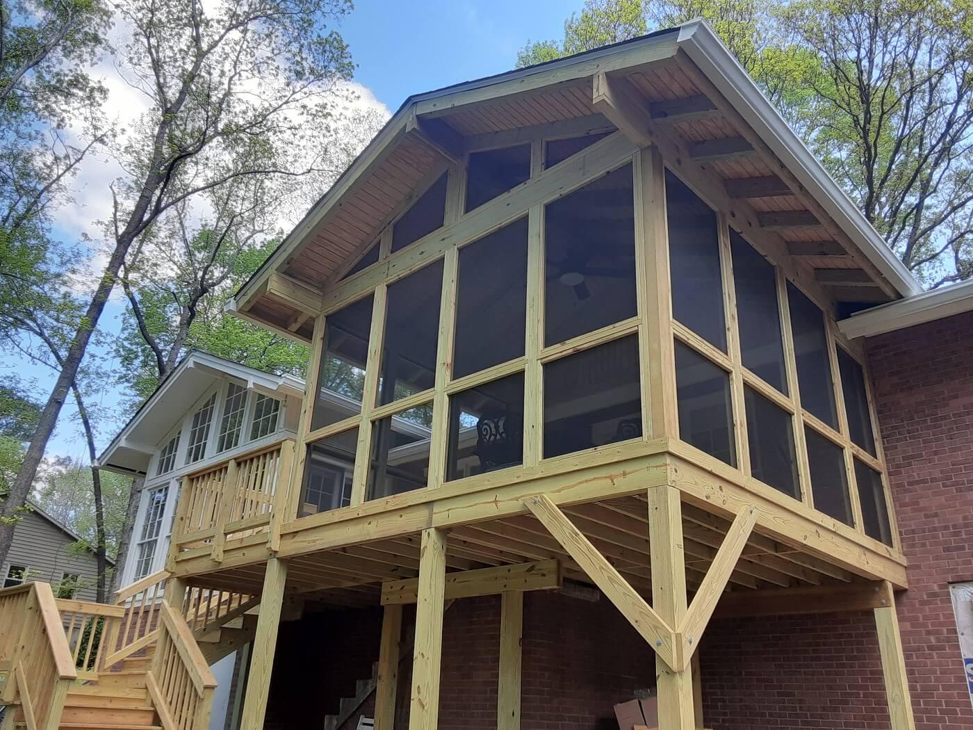 Custom backyard screened porch and deck