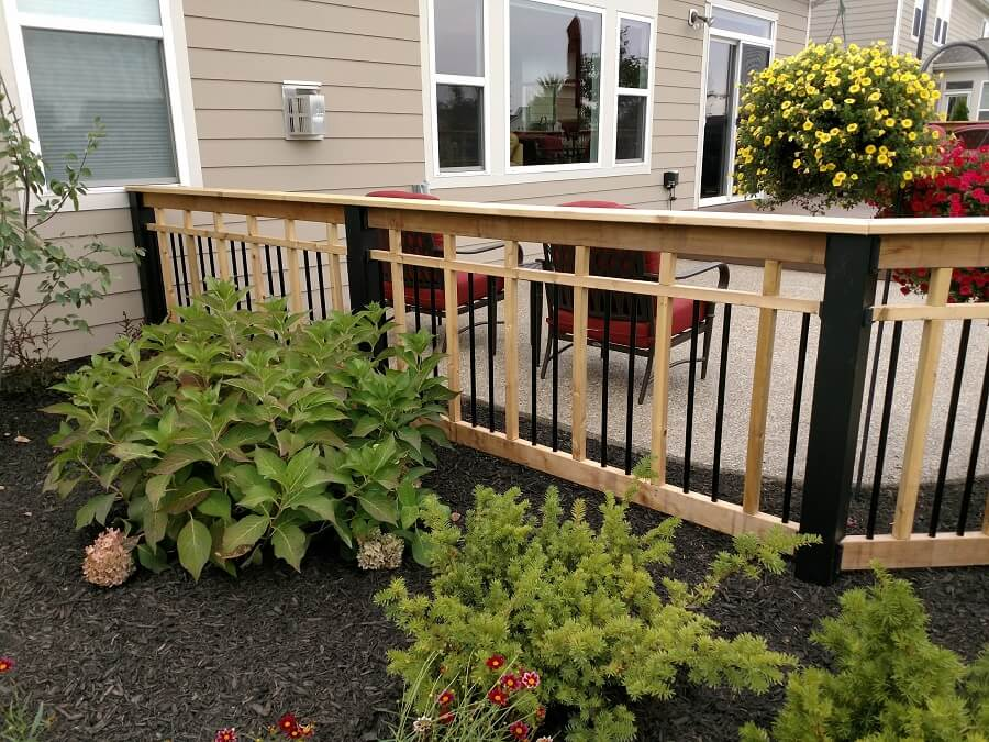 deck with railings and plants