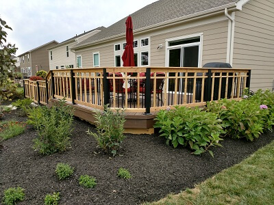deck with railings and plants on the side