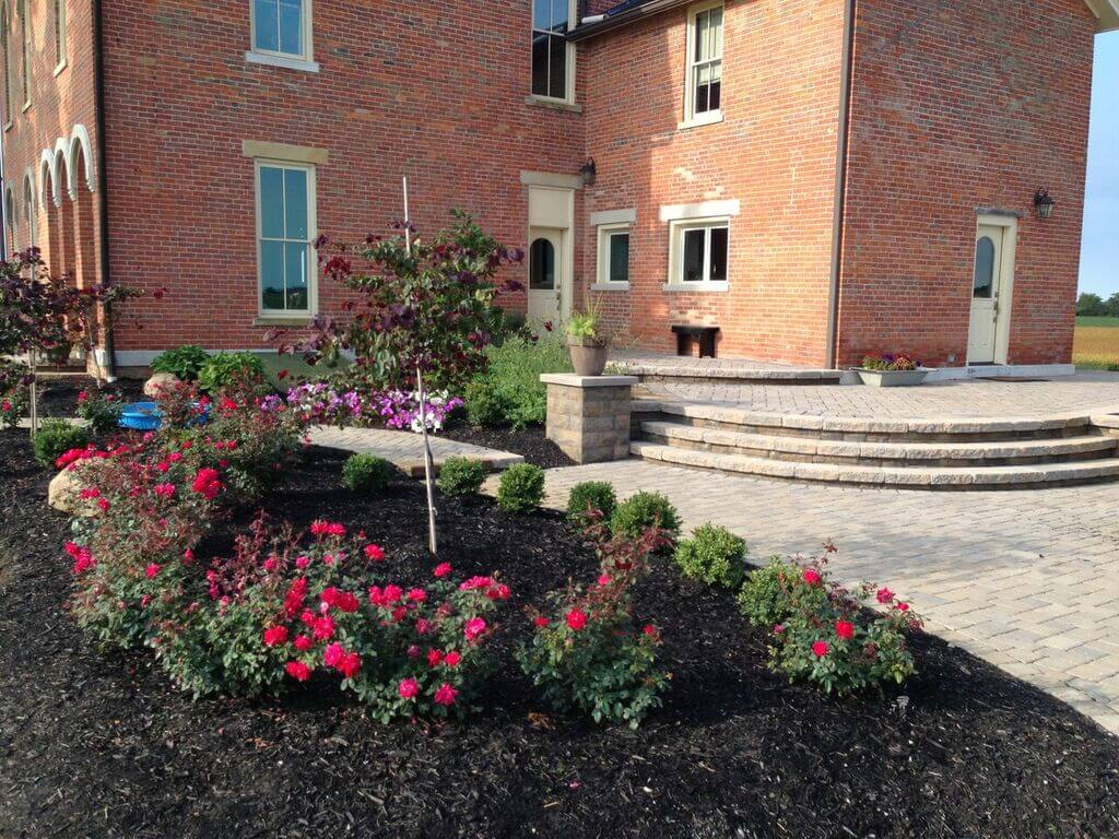 stone patio with flowers and plants