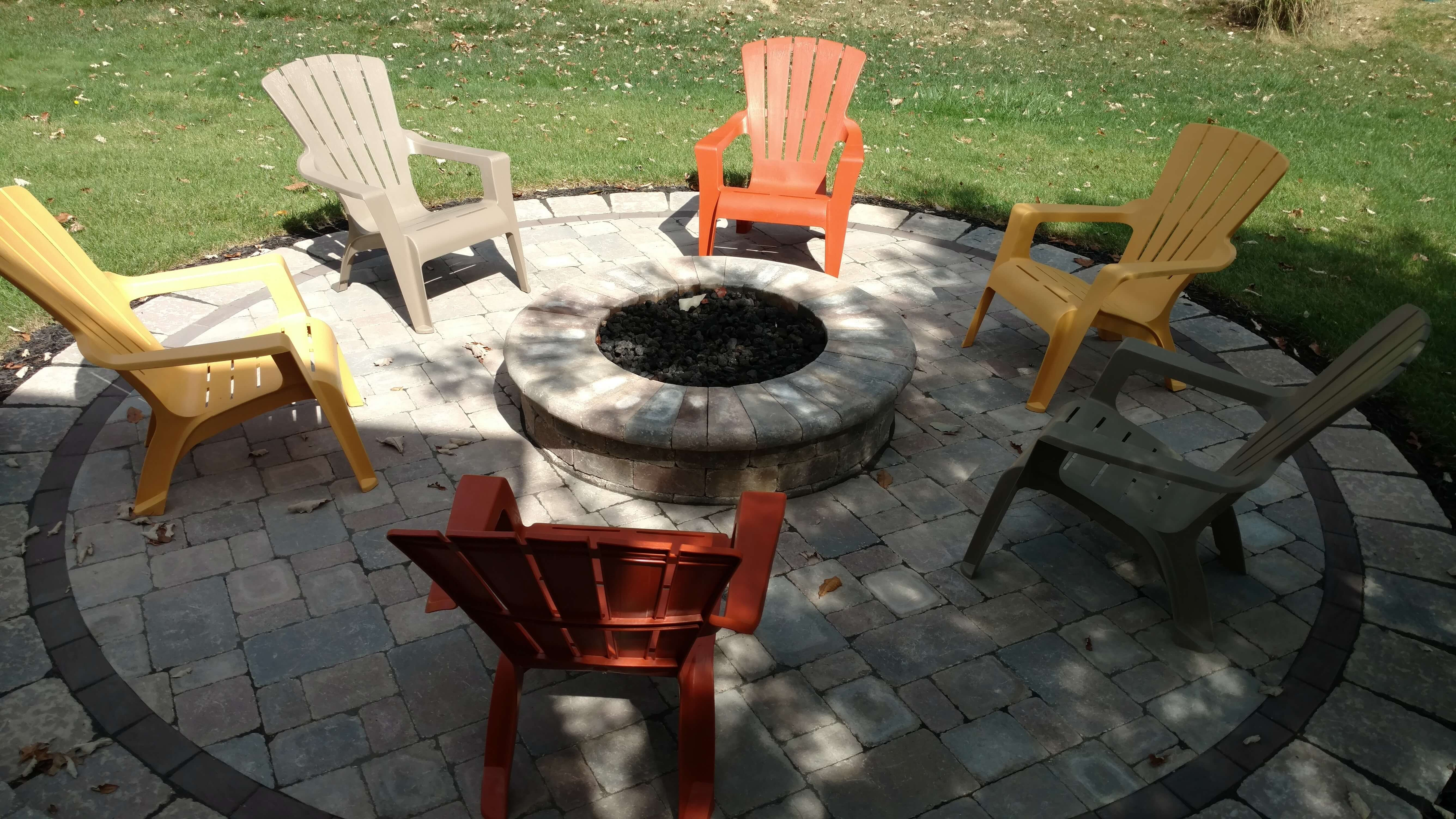 Custom fire pit with colorful chairs