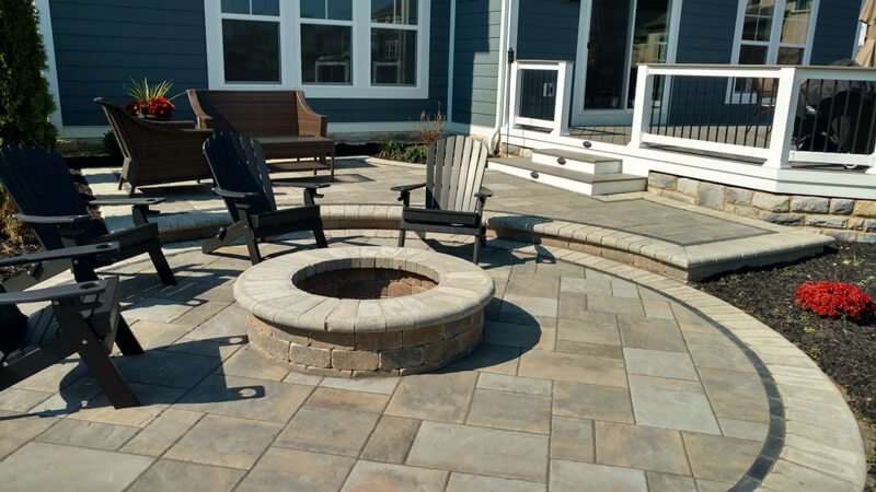 Custom patio with fire pit and seats