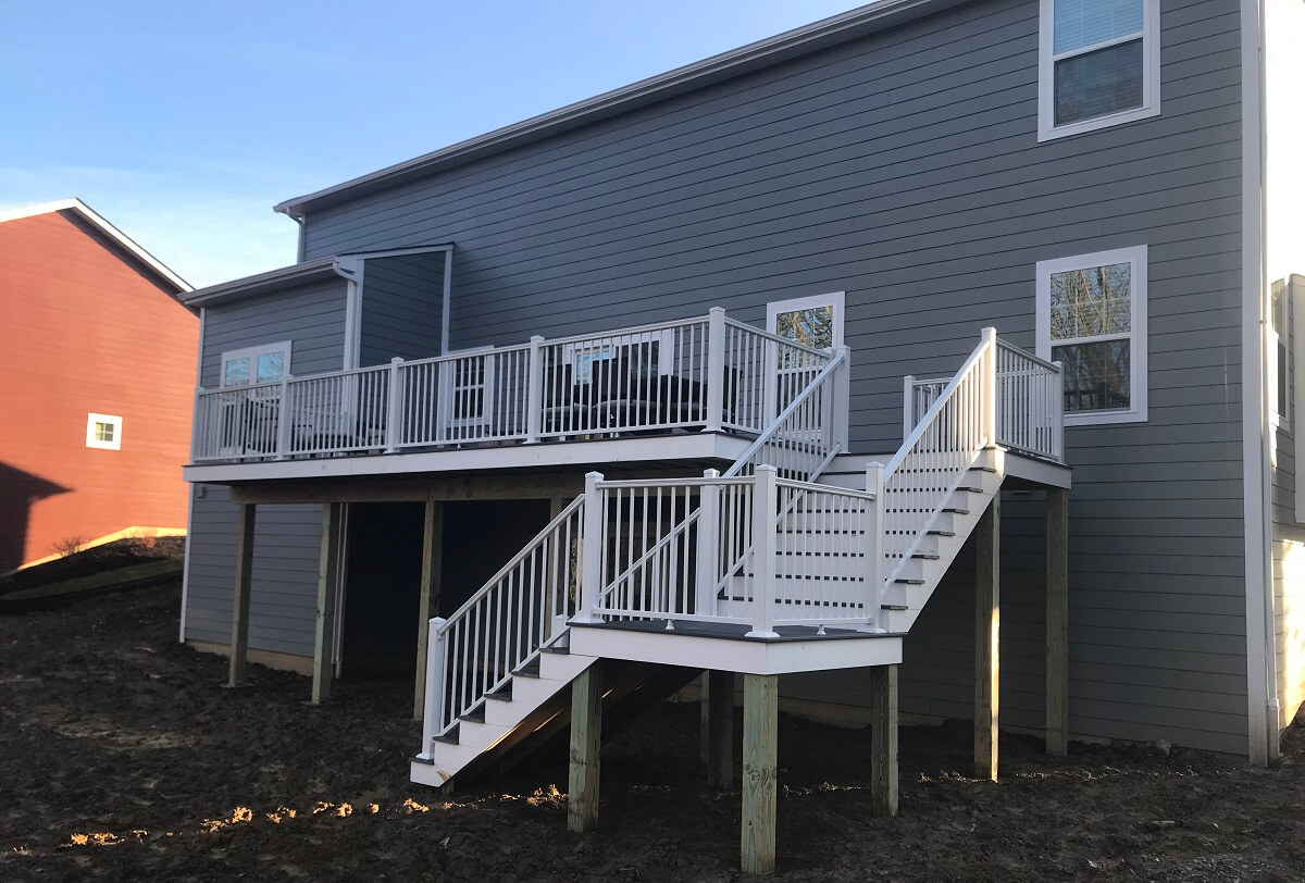 Custom elevated deck with white railing and staircase