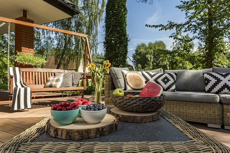 Cozy custom deck with assorted fruits on table