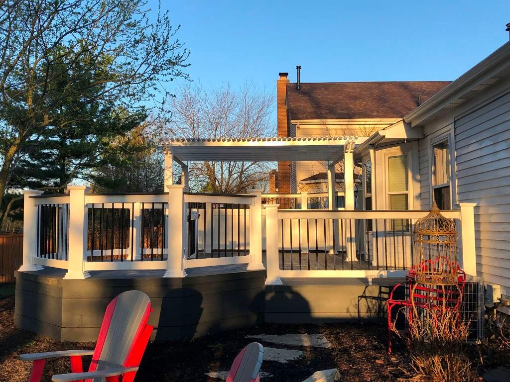 Custom deck with deck gate and white pergola