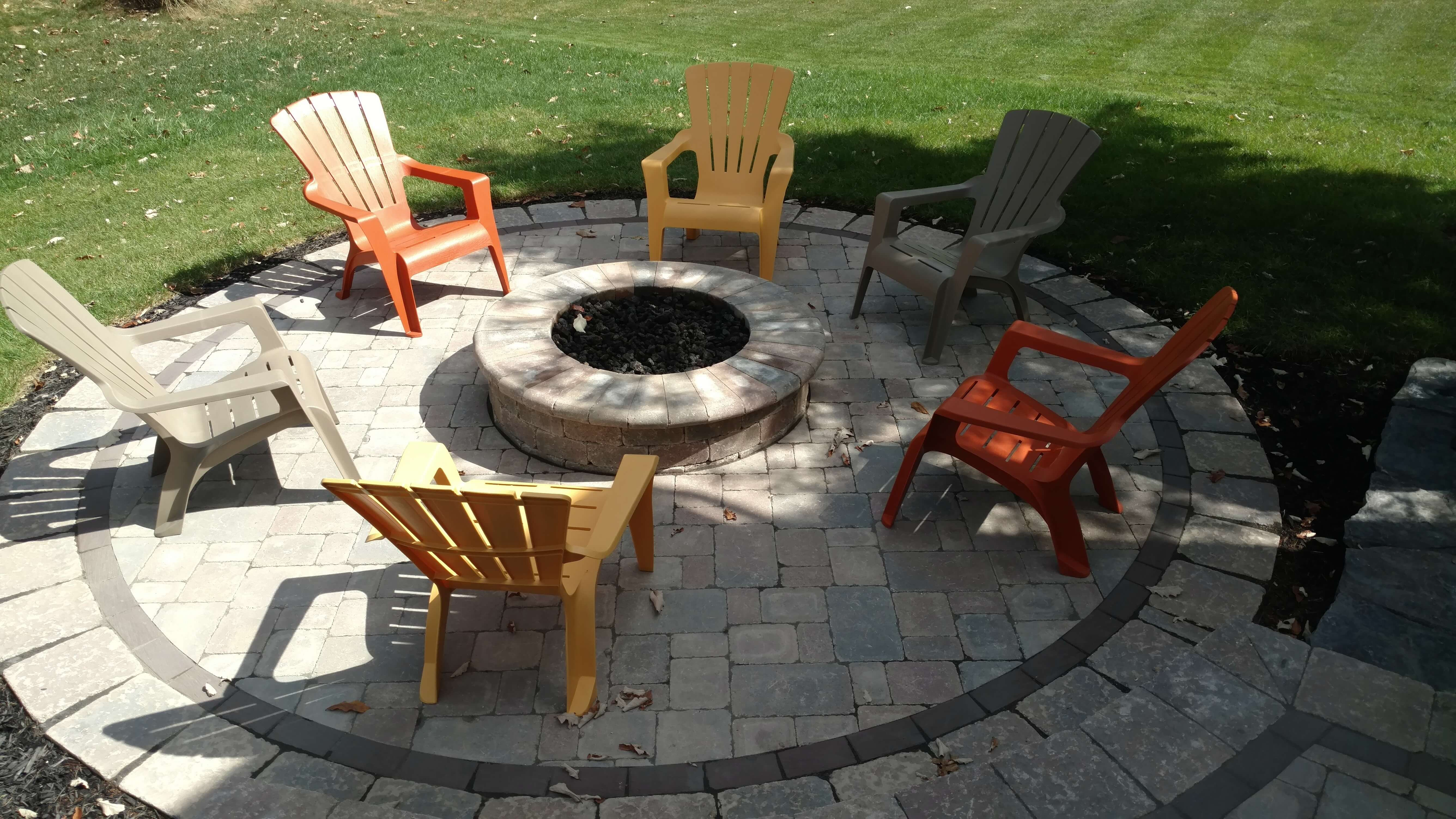 Fire pit on patio with chairs